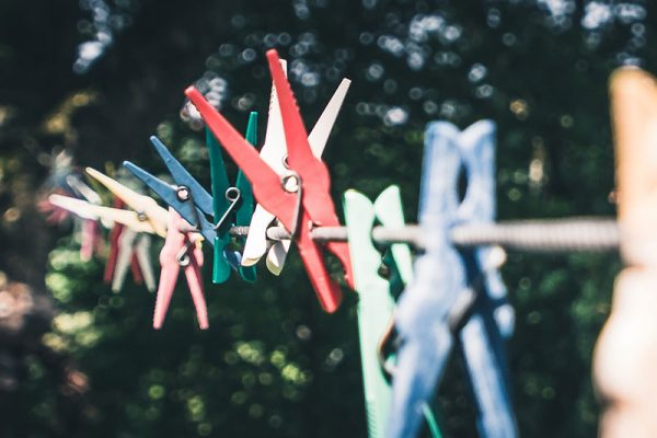 Coloured pegs on a washing line