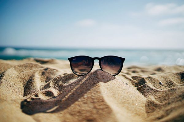 Sunglasses on a sandy holiday beach