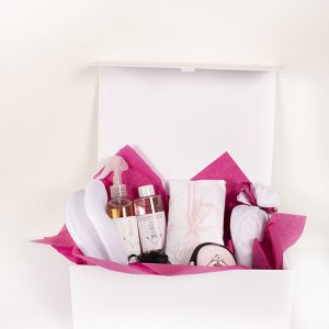 Luxury cashmere products in a white gift box